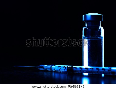 Vial and syringe with needle. Dark blue. MANY OTHER MEDICAL PHOTOS OF VIALS, SYRINGES ETC. IN MY PORTFOLIO