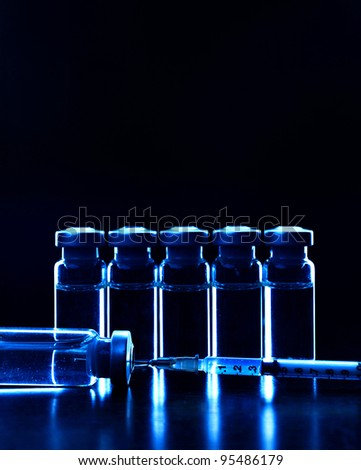 Vials of medications. Dark blue. MANY OTHER PHOTOS OF VIALS, SYRINGES IN MY PORTFOLIO