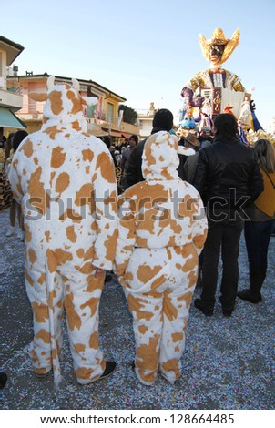 VIAREGGIO, ITALY - FEB 10: Masked participants on the street at carnival  of Viareggio, Viareggio carnival , February 10, 2013 in Viareggio, Italy.