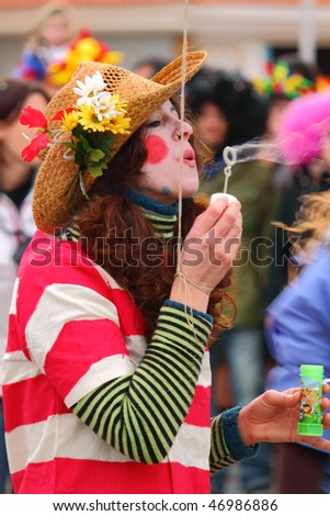 VIAREGGIO, ITALY - FEBRUARY 14: Beautiful young woman making soap bubbles in carnival mask, during the famous Carnival of Viareggio February 14, 2010 in Viareggio, Italy