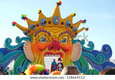 VIAREGGIO, ITALY - 10 FEBRUARY 2013 : -Carnival of Viareggio. Carnival mask.Colorful main stage, like big carnival mask with presenters of festival .Viareggio, February 10, 2013 in Viareggio,Italy