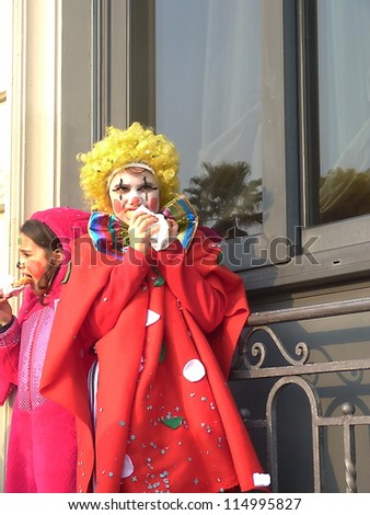 VIAREGGIO, ITALY - MARCH 4 An undefined child in carnival mask at the parades on the promenade during the famous annual Italian Carnival of Viareggio on march 4, 2012 in Viareggio, Italy