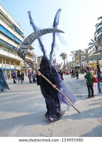 VIAREGGIO, ITALY - MARCH 4 An undefined man in carnival mask at the parades on the promenade during the famous annual Italian Carnival of Viareggio on march 4, 2012  in Viareggio, Italy
