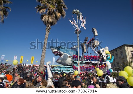 VIAREGGIO, ITALY - MARCH 6:  Carnival float of greenpeace with a giant shark on the promenade of Viareggio, during the famous Carnival of Viareggio  on march 6, 2011 in Viareggio, Italy