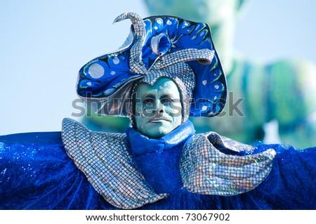 VIAREGGIO, ITALY - MARCH 8:  man in carnival mask, during the famous Carnival of Viareggio on march 8, 2011 in Viareggio, Italy