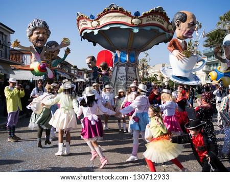 VIAREGGIO,ITALY-MARCH. 03: masked people take part  at the last parade of the 2013 edition of Viareggio's carnival on third march,2013 in Viareggio,Italy