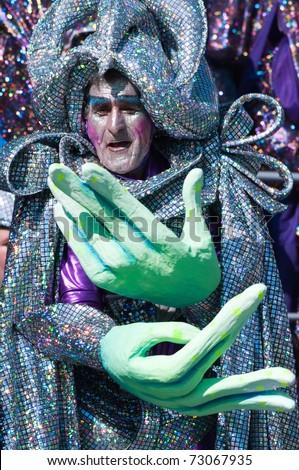 VIAREGGIO, ITALY - MARCH 6:  old man in carnival mask, during the famous Carnival of Viareggio on march 6, 2011 in Viareggio, Italy