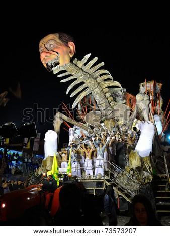 VIAREGGIO - MARCH 8: Night carnival floats parade on the promenade of Viareggio, during the famous Carnival of Viareggio on March 8, 2011 in Viareggio, Italy