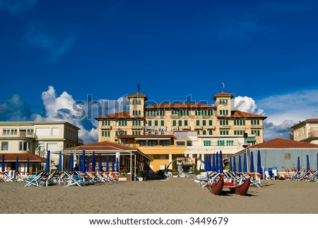 Viareggio's sandy beach with an old style hotel in the background