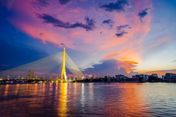 Vibrance and saturated twilight of Rama 8 bridge, the famous landmark in Bangkok, Thailand