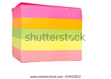 Vibrant block of multicolored post it notes isolated on white.
