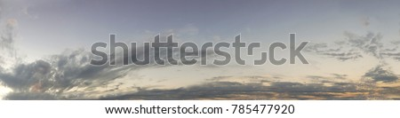 Vibrant color panoramic sun rise and sun set sky with cloud on a cloudy day. Beautiful cirrus cloud. Panorama high resolution photograph.