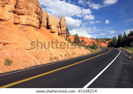 Vibrant colors of red sandstone delight travelers along the highway to Bryce National Park when they pass through scenic Red Canyon