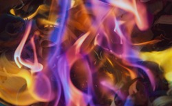 Vibrant colourful fire with flames in purple, blue and yellow