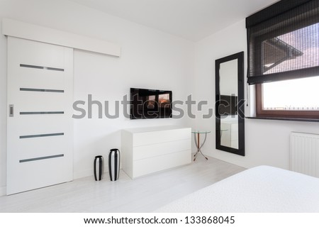 Vibrant cottage - white commode and black tv in bedroom
