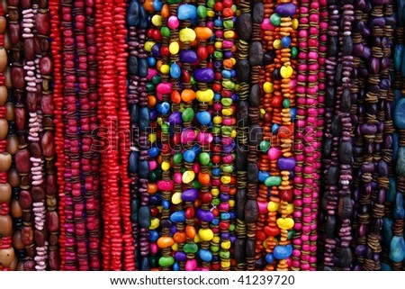 Vibrant ethnic necklaces from seeds on the market