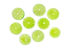 Vibrant fresh lime slices, shot from above on a white background