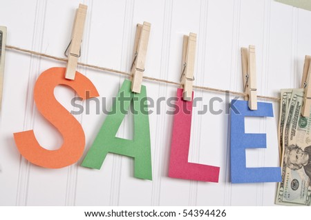 Vibrant Image for Your Next SALE featuring the word SALE and American Currency.