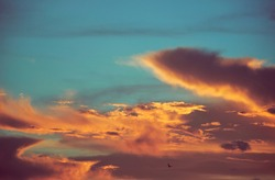 Vibrant looking fiery cloudscape during sunset. Photo taken during a monsoon evening.