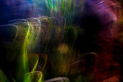Vibrant, multicolor, mixed-element, abstract, motion-blurred, mountain foliage in heavy shadows background texture