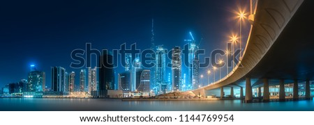 Vibrant panoramic view of Dubai Business bay at evening light, UAE