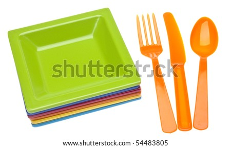 Vibrant Plastic Plates and Silverware.  Isolated on White with a Clipping Path.