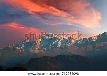 Vibrant red sunset with cirrostratus clouds over Kedarnath mountain of Gangotri Range of peaks in the western Garhwal Himalaya in Uttarakhand state, India. View from Chopta village.
