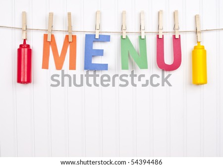 Vibrant Scene with the Word Menu and Ketchup and Mustard Bottles as the Focus on the Image.