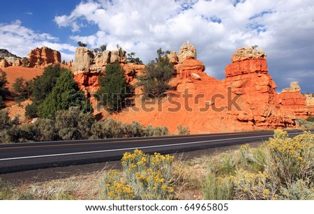 Vibrant spires of luminous orange sandstone are visible from the highway in Red Canyon, just outside of Bryce National Park in Utah