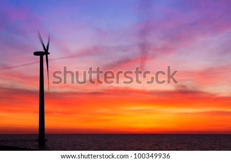 Vibrant windmill sunset - stock photo