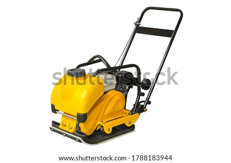 Vibratory plate compactor designed for the compaction of granular, mixed materials with some cohesive content Foto stock ©