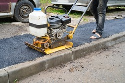 Vibroplite, a construction tool that performs trambing work of pavement. laying asphalt. roadworks