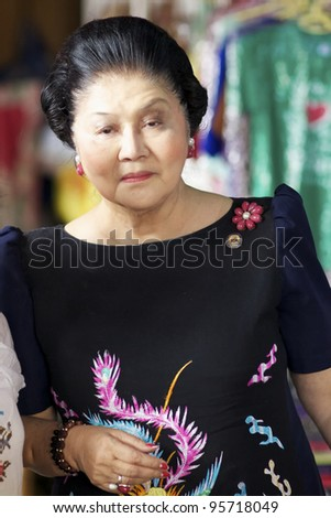 VICAN CITY, PHILIPPINES - FEB 19: Former Philippines First Lady Imelda Marcos shopping amongst supporters in Vican City, Philippines on February 19, 2012. She is widow of President Ferdinand Marcos