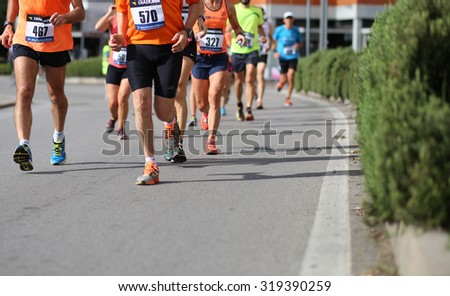 "Vicenza, Italy. 20th September 2015.  Marathon runners during the race called ""Mezza di Vicenza"" in city street of Vicenza in Northern Italy.The runners have raced meters 21097 #319390259"