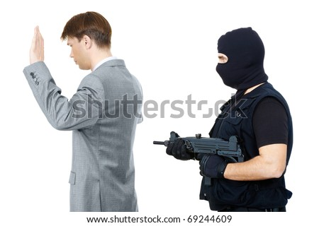 Victim standing with hands raised while mafia representative pointing gun at them behind