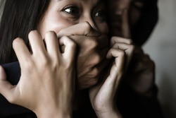 Victim young woman get shock and terrified when bad guy use hand close her mouth for stop scream Dangerous man want to abducted her for ransom Kidnap asian girl is one of victim of human trafficking