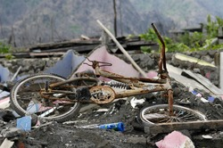 victims of the eruption of Mount Merapi in Indonesia in October 2010. Remaining of the disaster hit by a pyroclastic flow from the volcano