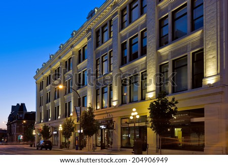 VICTORIA, BC - CIRCA JULY 2014 - The Hudson Bay building at night. The Hudson Bay building is a landmark in Victoria's Old Town District.