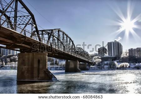 Victoria Bridge over the icy South Saskatchewan River in the city of Saskatoon, Canada