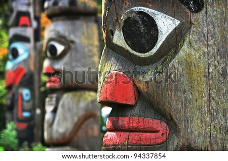 VICTORIA, CANADA - AUGUST 05: Totem poles in Thunderbird Park of Victoria, Canada on August 05, 2011. The park is part of the Royal BC Museum Cultural Precinct and home to many First Nations monuments