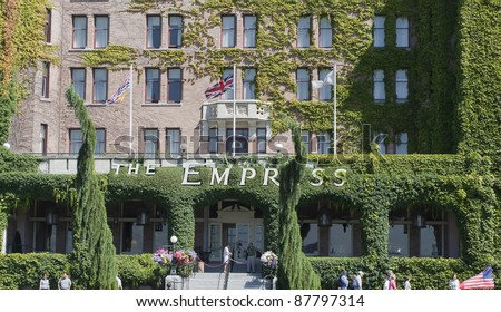 VICTORIA, CANADA - AUGUST 02: Tourists in front of the Fairmont Empress Hotel in Victoria, Canada on August 02, 2005. This luxury hotel was opened 1908 and welcome many Hollywood celebrities.