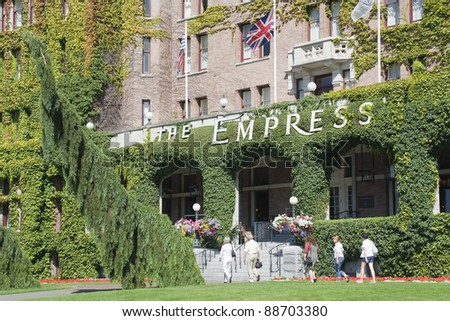 VICTORIA, CANADA - AUGUST 02: Tourists in front of the Fairmont Empress Hotel in Victoria, Canada on August 02, 2005. This luxury hotel was opened 1908 and welcomed many Hollywood celebrities.