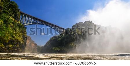 Victoria Falls, located on the Zambezi River on the border between Zambia and Zimbabwe. #689065996