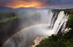 Victoria Falls sunset with rainbow, Zambia