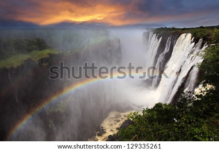 Victoria Falls sunset with rainbow, Zambia ストックフォト ©