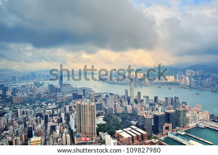 Victoria Harbor aerial view and skyline in Hong Kong with urban skyscrapers.