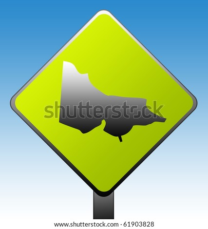 Victoria in Australia green diamond shaped road sign with gradient blue sky background.