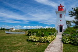 Victoria lighthouse with dinghy on Prince Edward Island, Canada
