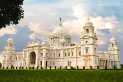Victoria Memorial Kolkata at sunset with vibrant moody sky in the background. Victoria Memorial is a monument and museum built in the memory of Queen Victoria in 1921 at Kolkata in India