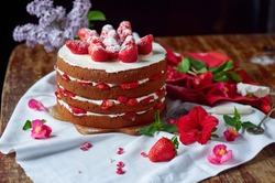 Victoria sponge cake with cream and strawberry on table with flower decor